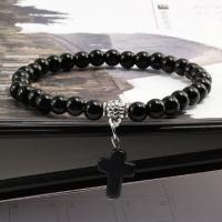 Браслет из черных каменных бусин с крестом